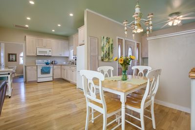 Dining area with seating for four, with a view to the newly updated kitchen.