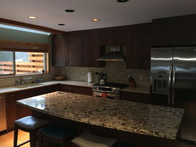 Full kitchen with all appliances including gas stove, microwave, dishwasher, etc