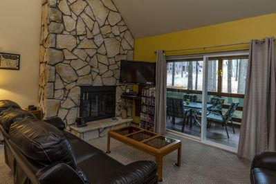 Living room with walk out patio for entertaining