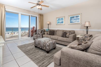 Accommodating living room area - Plenty of seating for the entire party to relax after a long day in the Florida sun. Take in more of the amazing view or watch the game and a movie.
