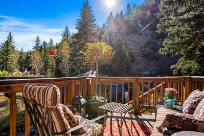 Relax on the elevated private deck, surrounded by nature.