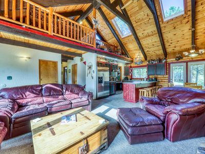 Photo for Beautiful, dog-friendly cabin w/ a private hot tub on almost two wooded acres