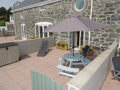 Photo for Stunning views of Cardigan Bay, quiet location, dogs welcome on a farm