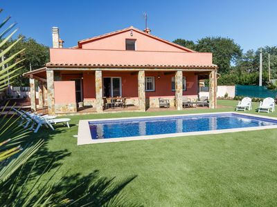 Photo for This 4-bedroom villa for up to 10 guests is located in Caldes De Malavella and has a private swimmin