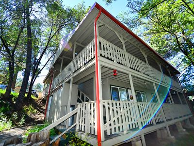 Photo for Relax In Mid-town On The River! AMAZING location - Optional HOT TUB EXPERIENCE