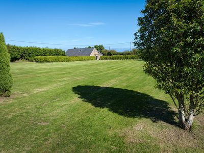 Photo for Perfect for large families or groups, this well presented detached house sits on a large plot with f