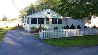 Photo for Charming 2 bedroom cottage In a wooded Wells neighborhood very near the beach