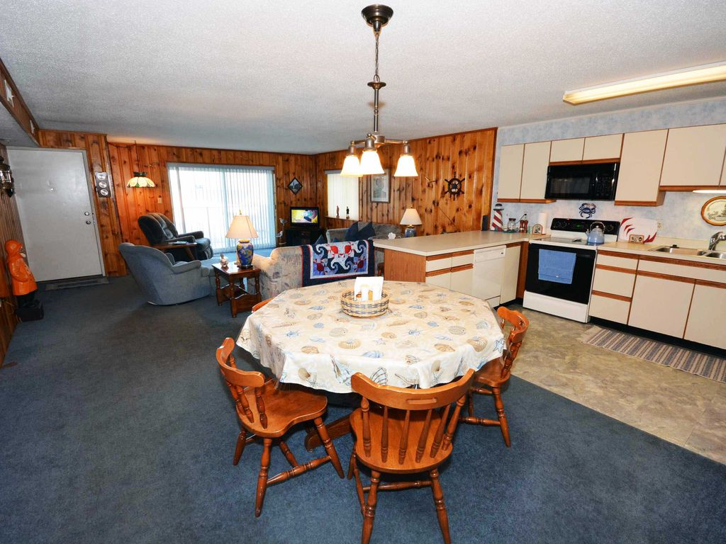 Warm, spacious 3 bedroom condo with free WiFi and ship-like wood paneling located midtown on the ocean block just a short stroll to the beach!