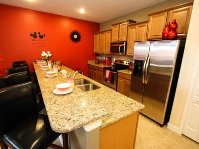 Photo for Lovely Mickey Townhouse with private pool, free WIFI, 7 miles to Disney!