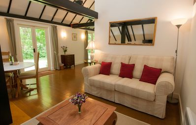 Sitting room with doors leading to the private garden