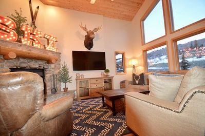 Family room w/ wood burning fireplace, TV w/ Dish Network