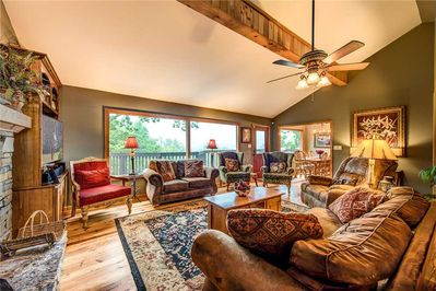 Room for the whole gang - The spacious living room has plenty of seating options—plush couches, comfy armchairs, a large recliner—so that everyone can congregate in comfort.