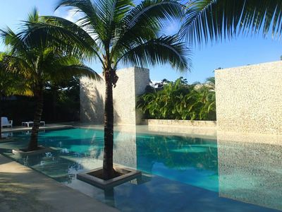 Photo for Spacious & modern condo with a fantastic pool.