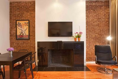 Original non-working fireplace with black granite hearth & mantle