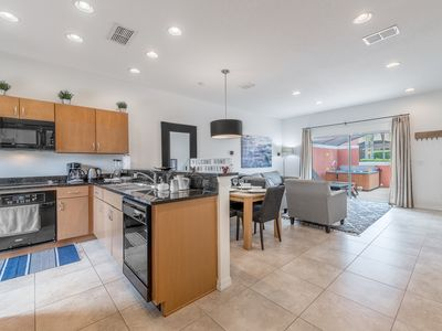 Photo for Resort living, next to Disney Townhome with hottub