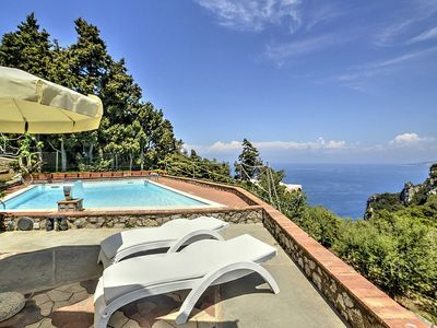 Photo for 5 bedroom Villa, sleeps 14 with Pool, Air Con, FREE WiFi and Walk to Shops