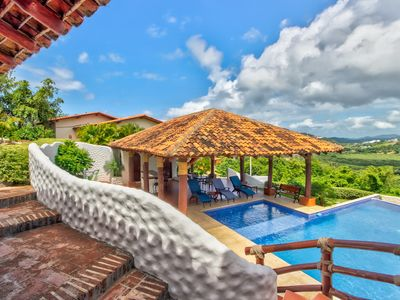 Photo for Long-term discounts: Stylish villa with shared pool only 1/4 mile from beach!