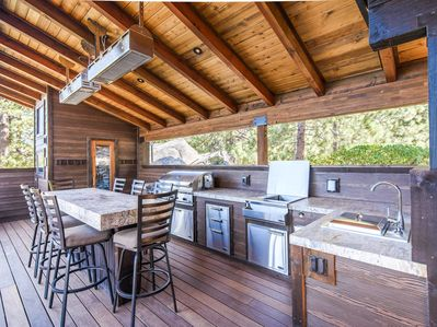 Outdoor Kitchen - A full outdoor kitchen and 10-person granite table await on the deck.