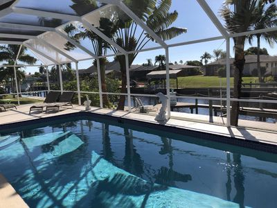 Photo for Gulf-access. Heated pool and boat dock. Beautiful sunsets. Villa Dolphin