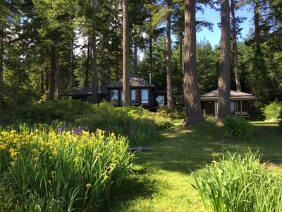 Photo for Waterfront modern architectural house in natural forested setting.