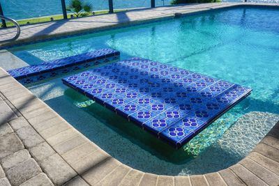 Sit in the pool at your beautifully tiled table, eat, drink and visit. The table includes a spot in the center to place an umbrella to keep you out of the sun.