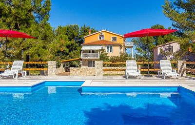 Photo for Apartment with large pool, 2 bedrooms, air conditioning, WiFi, terrace, barbecue and only 500 meters to the pebble beach