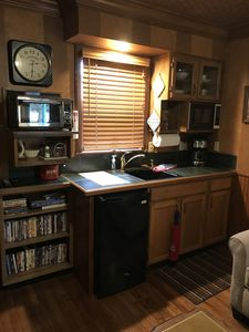 Kitchenette with bar fridge, coffee maker, toaster oven and microwave