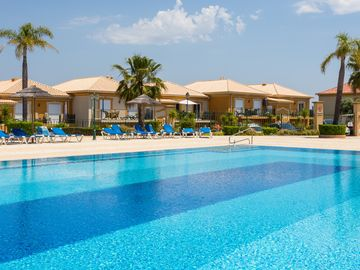 Apartment with heated communal pool, golf view, sky sport channels, and spa acce