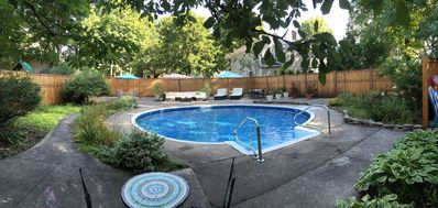 Photo for Comfortable home with secret pool area, porches & short walk to track & downtown