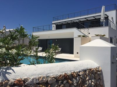 Photo for Menorca, Baleares, Beautiful villa / modern house with pool and sea views