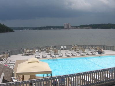 Our beautiful outdoor pool sitting on a point and overlooking  the lake.
