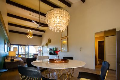 The beautiful dining table and shell chandelier.
