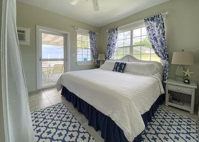 Ocean front bedroom with views of ocean and access to the veranda and beach.