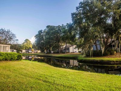 Photo for Lagoon lodging w/ onsite tennis courts & private deck!