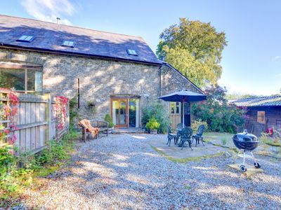 Photo for 17th Century barn conversion retaining much of its original character. Open plan living space with l