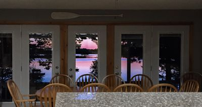Sunset views from lakeside house length of patio doors