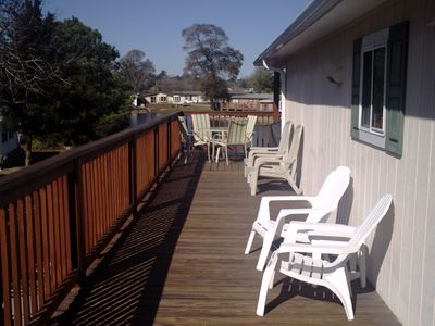 Wrap-around (southern view) wooden deck for tanning.  Dining table seats 4.