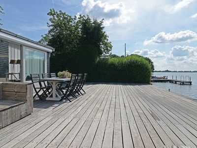 Photo for Stylish holiday home with gorgeous location right on the water (Reeuwijk Lakes)