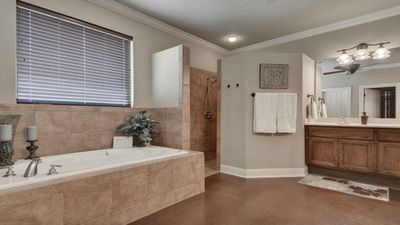 Master bath with giant tub, walk in shower and walk in closet