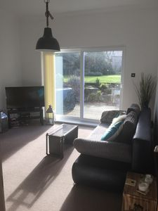 Living Room with patio doors to private decking and shared garden