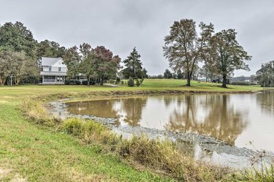 Nestled on 220 acres, this property offers a 2-acre catch-and-release pond.