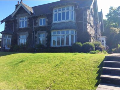 Photo for House On The Shore Of Lake Windermere with large garden & direct lake access &