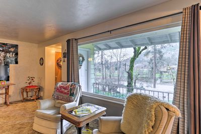 Curl up on the sofas to enjoy the scenic views from the picture window.