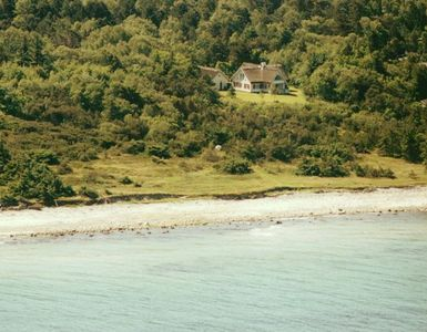 Our home from the air, surrounded by nature and the sea
