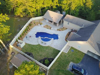 ariel view of pool and pool house