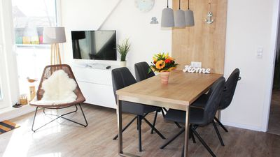 Photo for Modern and lovingly furnished apartment on Langeoog with 2 balconies