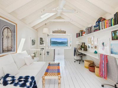Photo for Gorgeous and stylish whitewashed artist's cottage with amazing Pittwater views