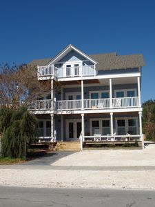 Front of the house with porches on each of the levels.