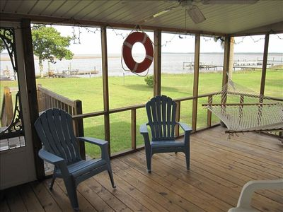 Enjoy coastal breezes while on the hammock on screened porch overlooking river