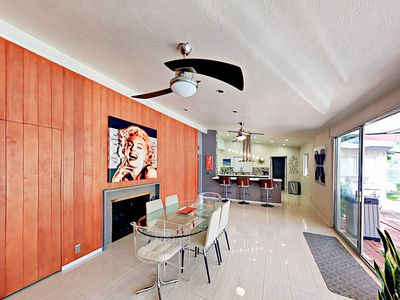 Dining Area - The dining area, between the great room and kitchen, has a glass-topped table with seating for 6, plus 3 bar stools.